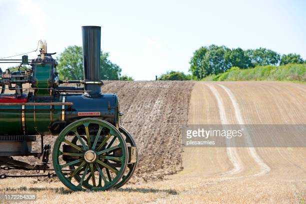 ploughed field and steam traction, england, uk - industrial revolution stock pictures, royalty-free photos & images