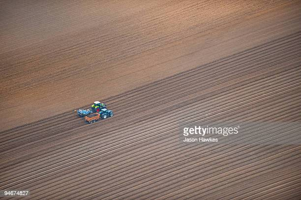 Ploughed field with farm machinery