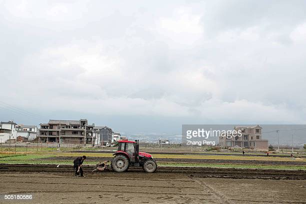 A ploughing machine is working in the fields During the 13th FiveYear Plan China will stress supplyside structural reforms in agriculture through...