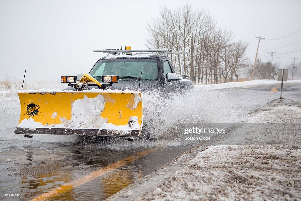 A plow made its way through flooded roads down route 1A in Salisbury as a large winter storm hit the region.