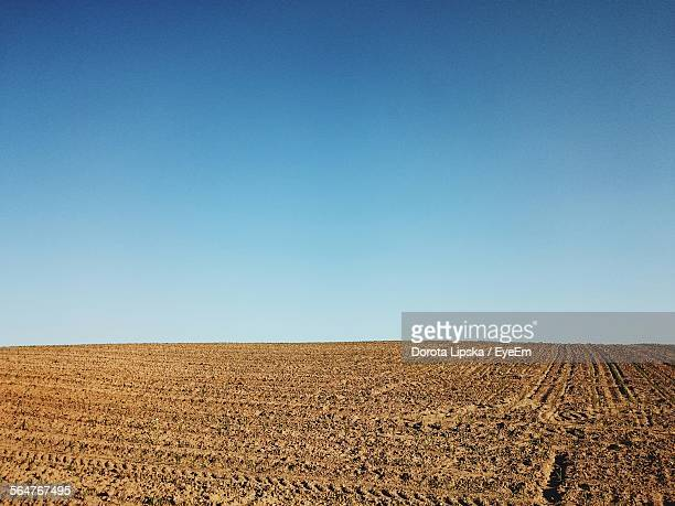 Plowed Field Against Blue Sky