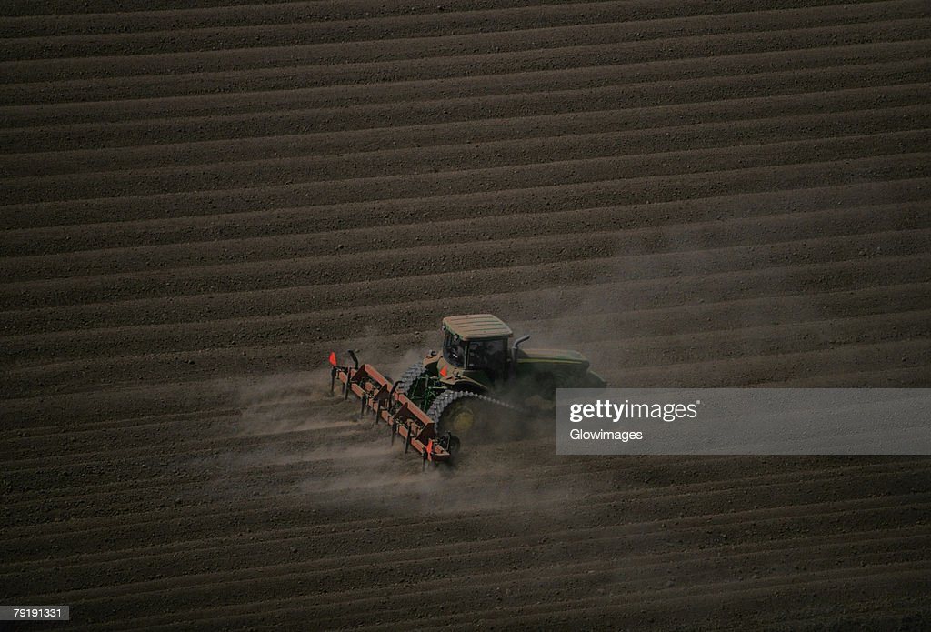 Plowing farm field, aerial : Stock Photo