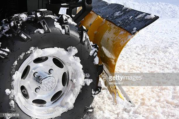 plowing snow with blade mounted on an atv - snowplow stock pictures, royalty-free photos & images