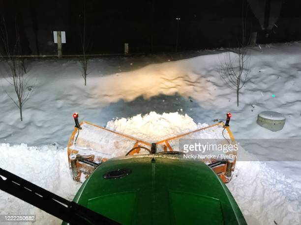plowing snow with tractor - オーデンセ ストックフォトと画像