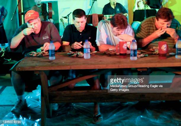 Plowville, PAContestants in the oyster eating contest work their way through their plates of shellfish. They are from left Dan Murphy of Muhlenberg,...