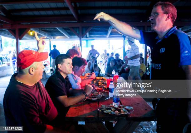 Plowville, PADan Murphy of Muhlenberg,is declared the winner in the oyster eating contest by judge Terry Algier. Sitting next to Dan contestant Mike...