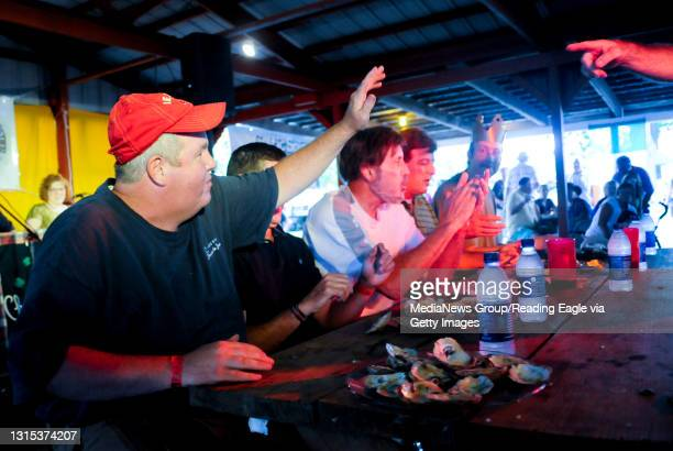 Plowville, PADan Murphy of Muhlenberg,is declared the winner in the oyster eating contest by judge Terry Algier.During the Celtic Oyster Festival at...