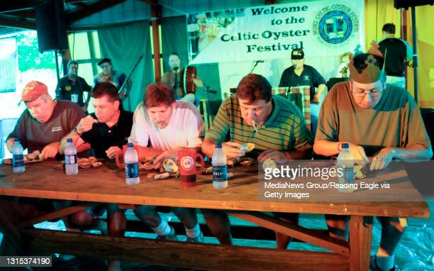 Plowville, PAThe five contestants in the oyster eating contest work their way through their plates of shellfish. They are from left Dan Murphy of...