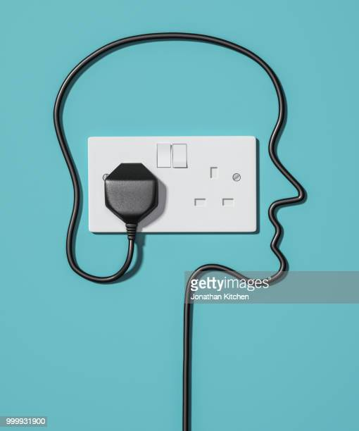 a plug socket with a human face - tomada - fotografias e filmes do acervo
