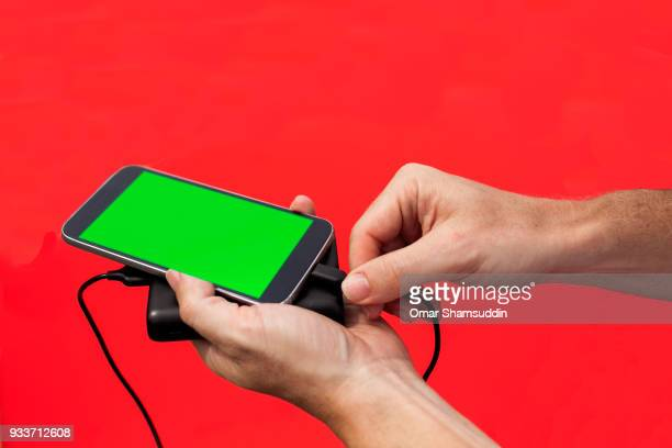 plugging in power bank charger for smartphone - omar shamsuddin stock pictures, royalty-free photos & images
