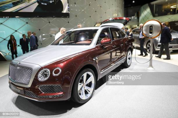 A plugin power dock made from sustainable materials and designed by the French designer Philippe Starck stands next to the 2019 Bentley Bentayga...