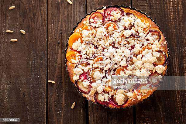 plum cake with pine nuts - carolafink stock pictures, royalty-free photos & images