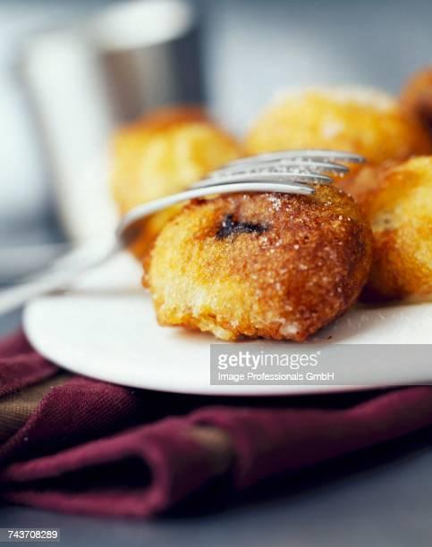 plum fritters with almonds - dörrpflaume stock-fotos und bilder