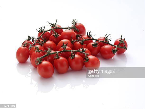 Plum tomatoes on vine