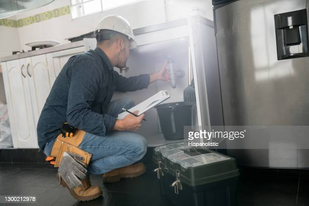 plumber fixing a problem with the sink in the kitchen - drain stock pictures, royalty-free photos & images