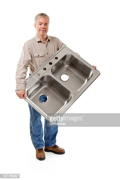 Plumber Holding a New Kitchen Sink