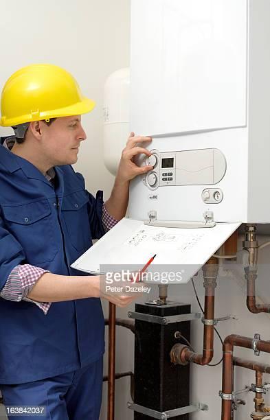 Plumber regulating boiler