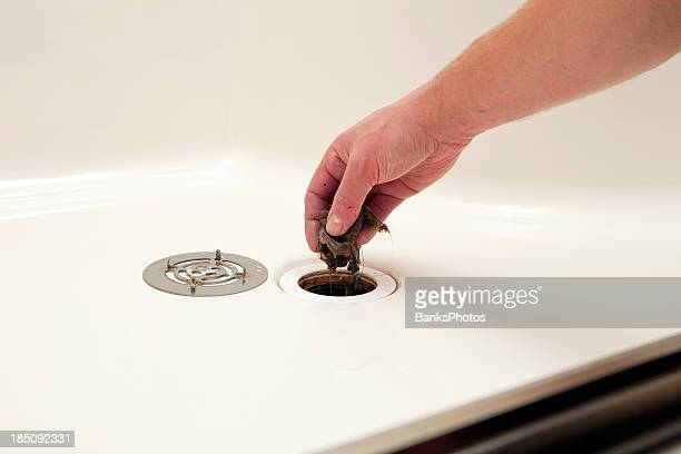 Plumber Removing Hair Clog from Shower Drain