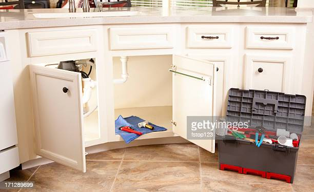 Plumber toolbox in domestic kitchen during service call