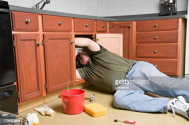 Plumber Under the Sink