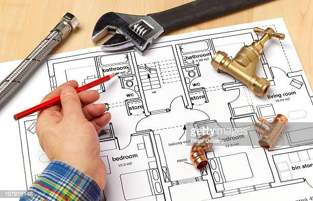 plumber with house plans - plumbing stock pictures, royalty-free photos & images