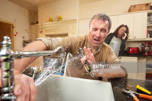plumbing mishap - negative emotion stock pictures, royalty-free photos & images