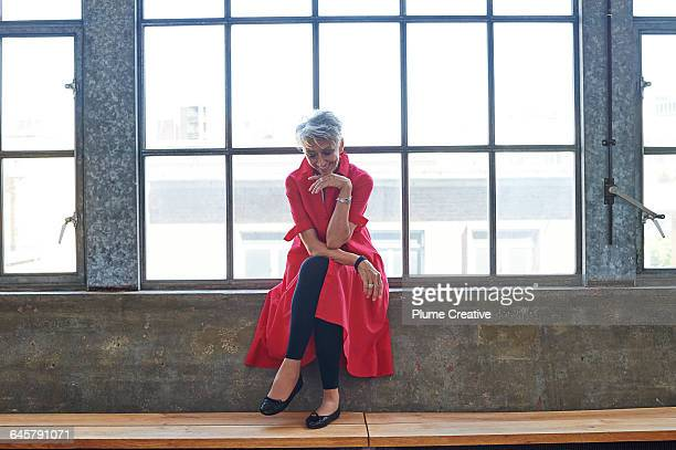 plume loft - red coat stock pictures, royalty-free photos & images