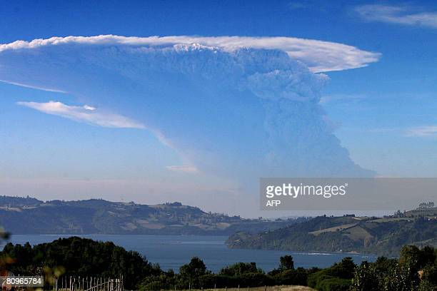 A plume of ashes spewed by the Chaiten volcano is seen from the city of Chaiten200km south from Santiago Chile on May 2 2008 About 1500 people will...