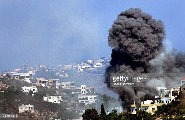 A plume of smoke billows in the Lebanese border village of Aita alShaab after is was hit by Israeli artillery during an operation August 1 2006 on...