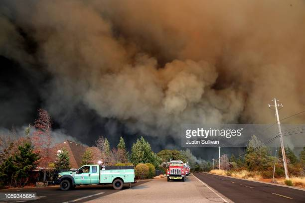 Plume of smoke rises above the Camp Fire as it moves through the area on November 8, 2018 in Paradise, California. Fueled by high winds and low...