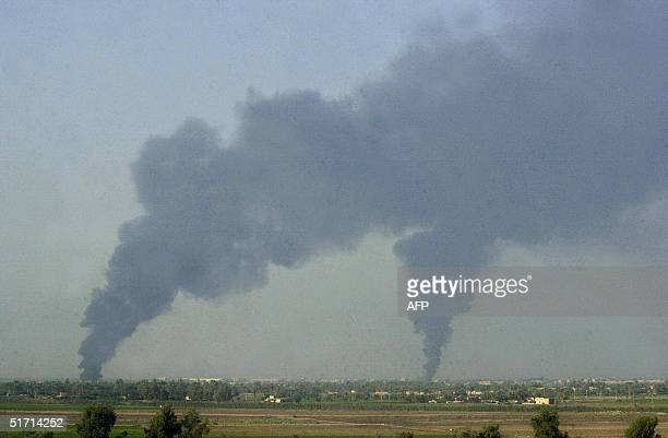 Plumes are seen on the outskirts of the restive city of Fallujah 50 kms west of Baghdad 10 November 2004 Crouching in mosques rebels traded fire with...