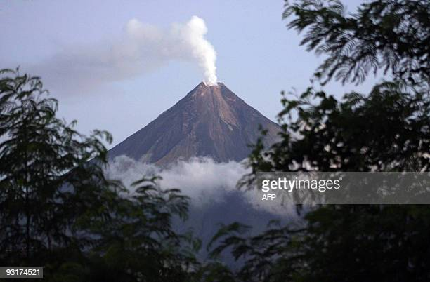 Plumes of ash and smoke stream from the top of the Mayon volcano in the Philipine town of Legazpi in Albay province south of Manila on November 15...