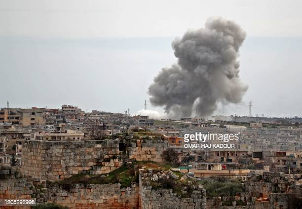 Plumes of smoke rise following Russian air strikes on the village of al-Bara in the southern part of Syria's northwestern Idlib province on March 5,...