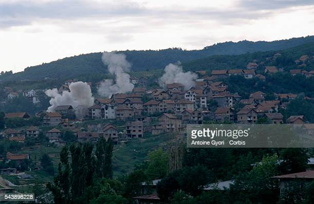 Plumes of smoke rise from a residential area of Sarajevo during the siege of the city in the Yugoslavian Civil War Serbian troops spread out into the...