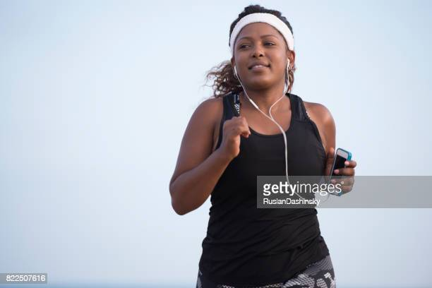 plump woman running outdoors. - israeli woman stock pictures, royalty-free photos & images
