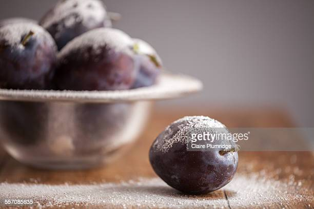 plums covered in icing sugar - plum stock pictures, royalty-free photos & images