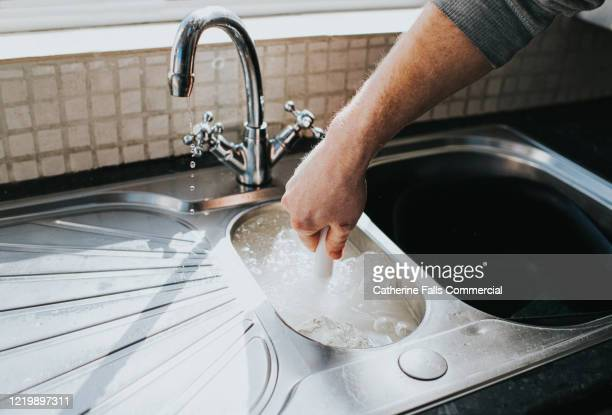 plunging a sink - drain stock pictures, royalty-free photos & images
