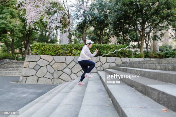 plus size japanese woman training at steps - fat asian woman stock pictures, royalty-free photos & images