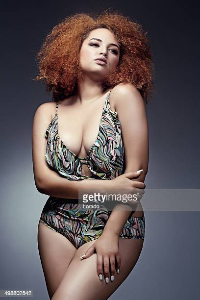 plus size lingerie model posing