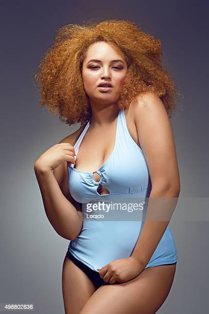 plus size lingerie model posing - chubby stock photos and pictures