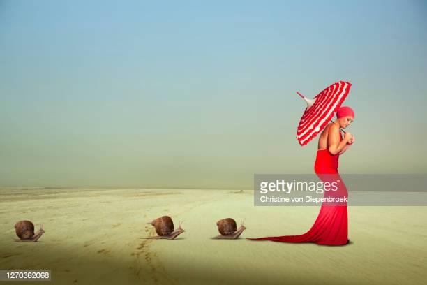 plus size model in red dress - haute couture stockfoto's en -beelden