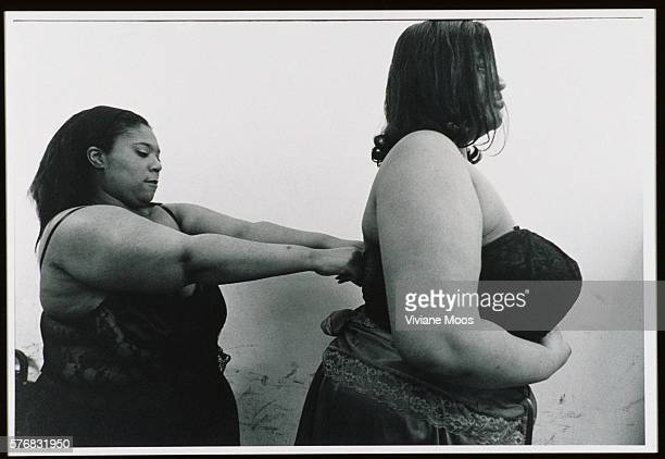 Plus Size Woman Assisting Another to Dress