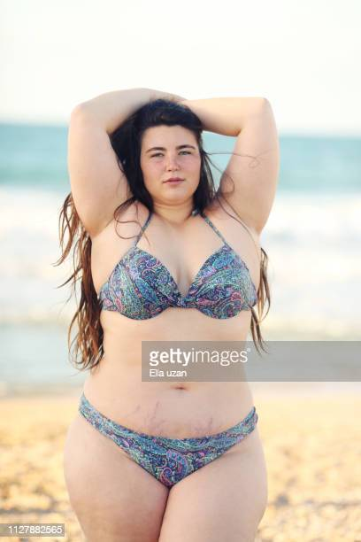 plus size woman at beach - fat woman at beach stock pictures, royalty-free photos & images