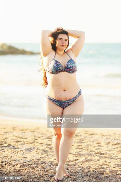 plus size woman at beach - plus size model stock pictures, royalty-free photos & images