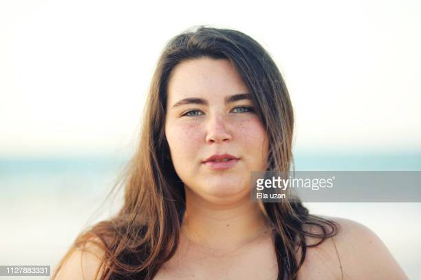 plus size woman at beach - beautiful israeli women stock pictures, royalty-free photos & images