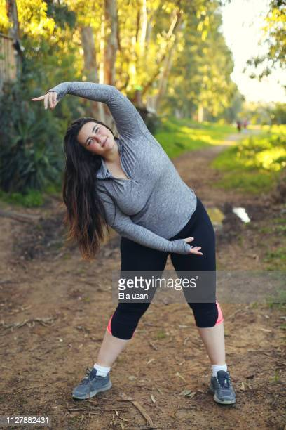 plus size woman exercising in the park