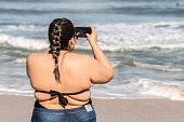 Plus Size Woman Photographing the Beach