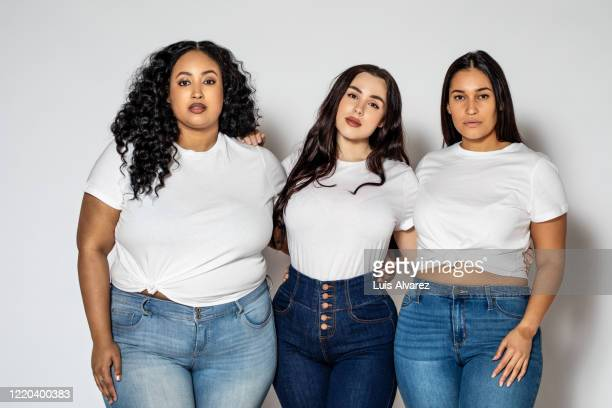 plus size women in casuals on white background - white t shirt stock pictures, royalty-free photos & images