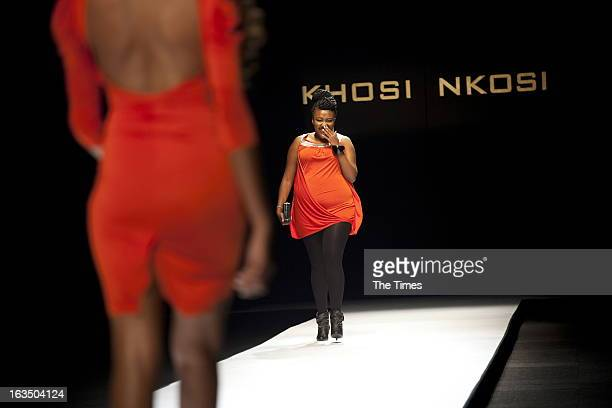 A plus sized model walks down the ramp during the Khosi Nkosi fashion show at the MercedesBenz Fashion Week on March 7 2013 in Newtown Johannesburg...