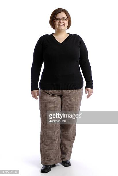Plus sized woman in professional attire posing confidently